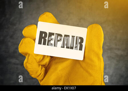 Repair on Business Card, Male Hand in Yellow Leather Construction Working Protective Gloves Holding Card with Rounded - Stock Photo
