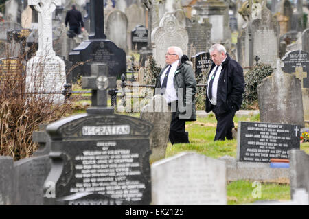 Belfast, Northern Ireland, UK. 5th April, 2015. Two men dressed in white shirts, black ties and black suits walk - Stock Photo