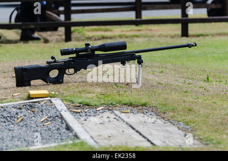 Remington 700P (police version) bolt action rifle with telescopic sights at a shooting range in Northern Ireland - Stock Photo