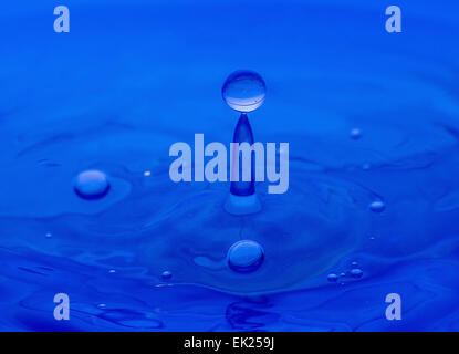 light,liquid,drop,circle,blue,water,wave,background,abstract,nature,motion,splash,shape,ripple,reflection,bubble,dew,color,macro - Stock Photo