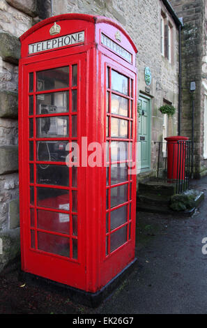 K6 Red Telephone Kiosk in Working Order on the Main Street of Winster in Derbyshire - Stock Photo