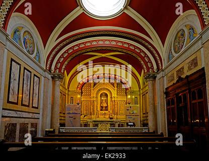 Side altar displaying the Child Jesus of Prague Icon in St. Teresa's Carmelite Church Clarendon street Dublin, Ireland - Stock Photo