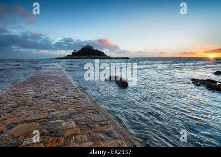 Sunset from Marazion in Cornwall looking out towards St Michael's Mount at high tide - Stock Photo