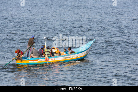 Local fishermen in a brightly coloured boat, Pondicherry, or Puducherry, Tamil Nadu, southern India - Stock Photo