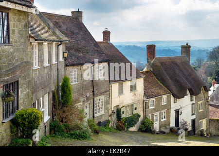A row of sleepy cottages on a cobbled street at Gold Hill in Shaftesbury, Dorset - Stock Photo
