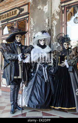 Three People in Carnival Mask and Costume, Venice, Italy - Stock Photo