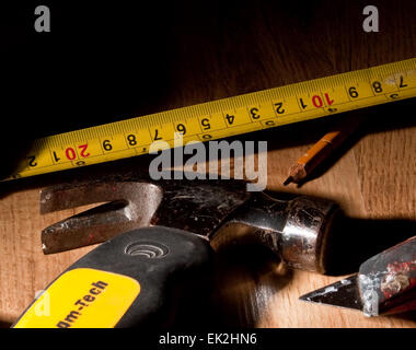 Assorted Tools on a wooden workbench - Stock Photo