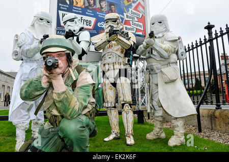 Fans dressed as Stormtroopers, Snow Troopers and an Alliance X-Wing pilot at MCM Comic Con Ireland - Stock Photo