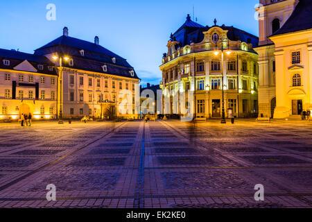 City hall and Brukenthal palace in Sibiu, Transylvania, Romania, at night - Stock Photo
