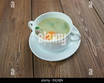 Hochzeitssuppe - wedding soup.German soup based on chicken broth, fortified with chicken meat, small meatballs - Stock Photo