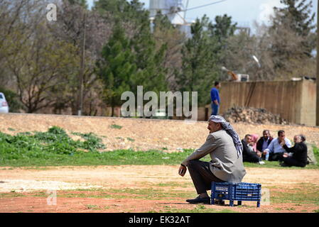 many children returning into Konbane with their parents. 3.4.2015, Kobane, Syria - Stock Photo