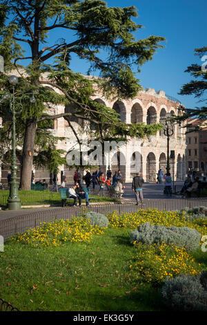 Tourists around Arena di Verona, Roman Colosseum in Piazza Bra, Verona, Veneto, Italy - Stock Photo