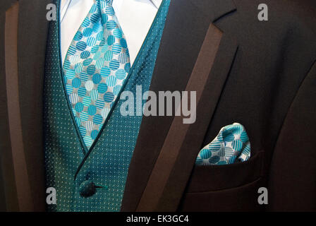 Close up of a teal and brown tuxedo. - Stock Photo