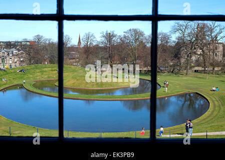Charles Jencks' Landform seen through the window of the Scottish National Gallery of Modern Art in Edinburgh. - Stock Photo