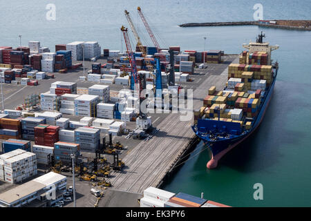 Port of Napier in New Zealand. Container loading area with cargo ship. - Stock Photo