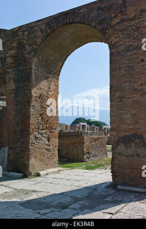 An arch in the Temple of Jupiter at the archaeological excavations of Roman Pompeii near Naples, Campania, Italy - Stock Photo