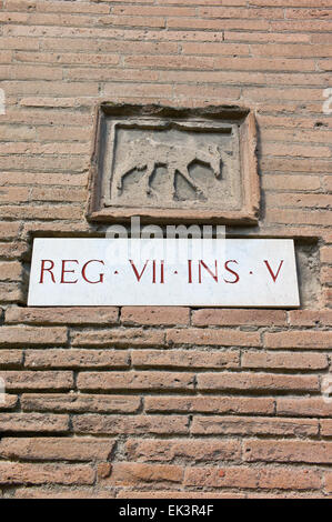 Archaeological system of Regional and Insula numbers on a building in Roman Pompeii, near Naples, Campania, Italy - Stock Photo