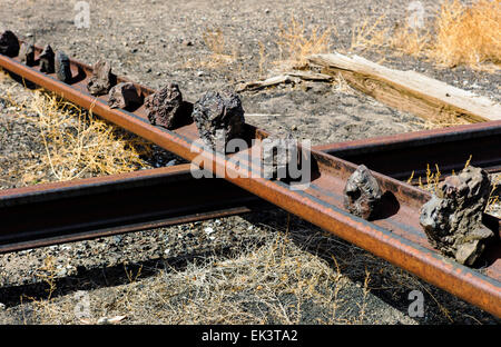 Barren land along Arkansas River owned by Union Pacific Railroad. An artist has creatively arranged some of the - Stock Photo