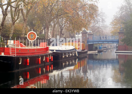 Houseboats on Regents Canal at Little Venice in London England United Kingdom Europe - Stock Photo