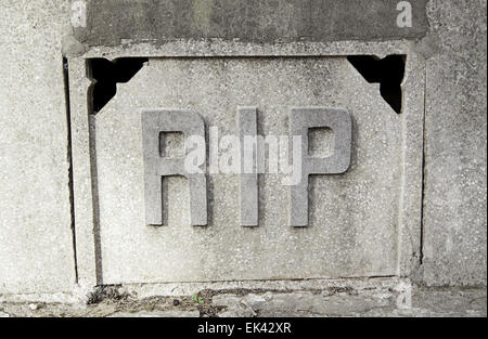 Sign rip in a tomb, detail of a signal in the cemetery, rest in peace - Stock Photo