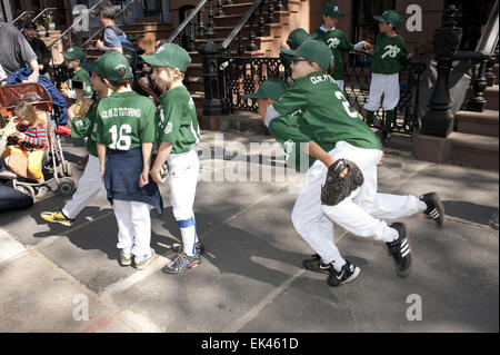 Team members await the start of the 2012 Little League Opening Day Parade in Park Slope. - Stock Photo