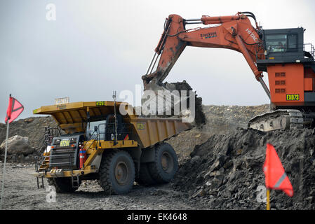 A 190 ton digger loads rock from a layer of overburden at open cast coal mine on August 31, 2013 near Westport, - Stock Photo