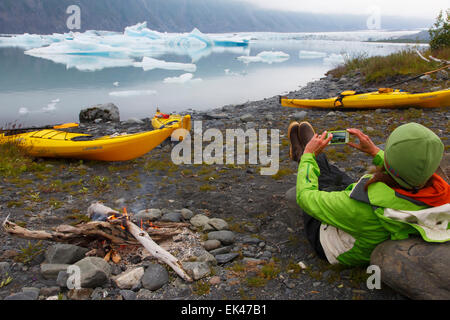 Kayaking and camping in Bear Glacier Lagoon, Kenai Fjords National Park, near Seward, Alaska.  (model released) - Stock Photo