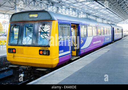 Railbus style 'Pacer' diesel multiple unit train operated by Northern Rail, waiting at a railway station platform; - Stock Photo