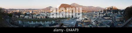 Panoramic view of historic city of Salzburg with river Salzach at dusk Austria - Stock Photo