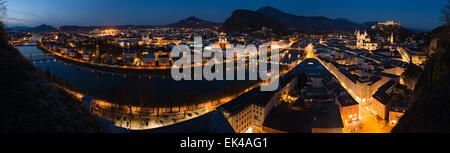 Panoramic view of historic city of Salzburg with river Salzach at night, Austria - Stock Photo