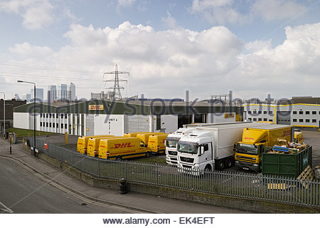 DHL depot at the Europa Trade Park and distant Canary Wharf skyline: Canning Town, London. - Stock Photo