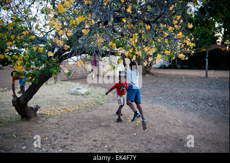 children at play in mahikeng formerly known as mafikeng - in an area called rhodes park that is along side the transnet - Stock Photo