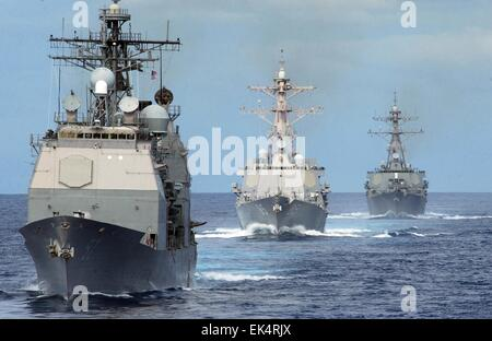 US Navy guided-missile cruiser USS Lake Champlain followed by the Arleigh Burke-class guided-missile destroyers - Stock Photo