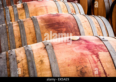 American oak barrels with traces of red wine - Stock Photo