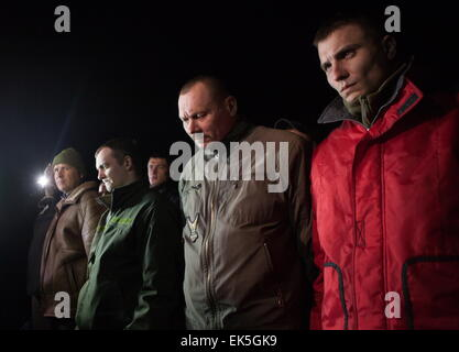 Donetsk Region, Ukraine. 6th Apr, 2015. Captured Ukrainian security officials seen during a handover ceremony at - Stock Photo