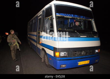Donetsk Region, Ukraine. 6th Apr, 2015. A bus carrying captured Ukrainian security officials during a handover ceremony - Stock Photo