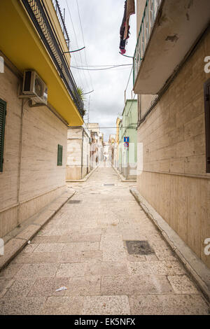Small hold street with rocks paved. Canosa DP, Puglia. Italy - Stock Photo