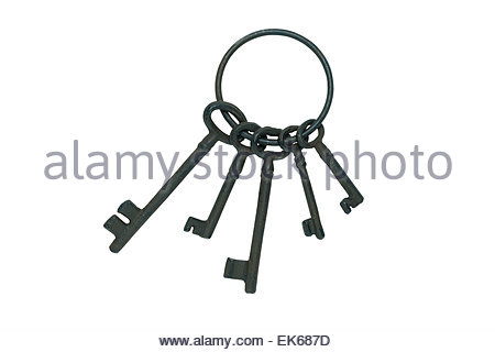 Old fashioned keys on keyring isolated on white background with clipping path - Stock Photo