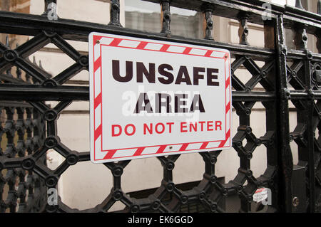 unsafe area, do not enter sign on railings in London UK - Stock Photo