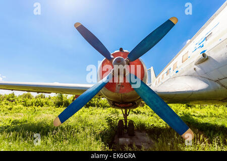 Turbine of old russian turboprop aircraft at the abandoned aerodrome in summertime - Stock Photo