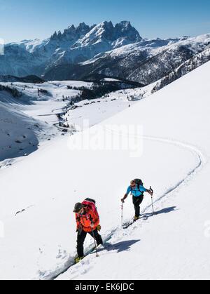 Backcountry skiers near the Rifugio Fuciade, Pale di San Martino, Dolomite Mountains, Alps, Italy - Stock Photo