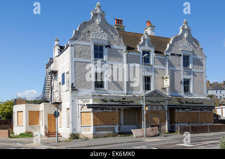Closed and boarded up restaurant in Newhaven East Sussex England United Kingdom UK - Stock Photo