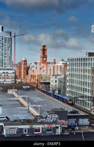 The Palace Hotel, on the Manchester skyline ata First train makes its way through the university - Stock Photo