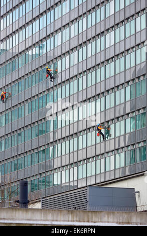 Manchester City Tower office block window cleaning team - Stock Photo