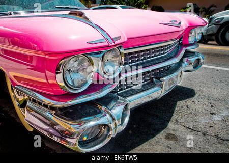 Front grille of a 1959 pink Cadillac El Dorado outside the Marlin Hotel on Collins Avenue, Miami Beach, Florida, - Stock Photo