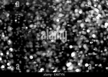 Blurred defocused lights on black - Stock Photo