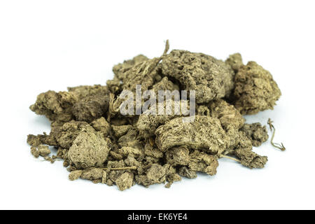 Pile of dry cow manure isolated on white background - Stock Photo