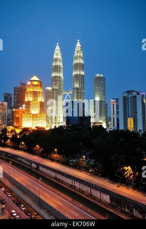 Vertical shot of Kuala Lumpur night scenery during blue hour, highway can be seen in this image. - Stock Photo