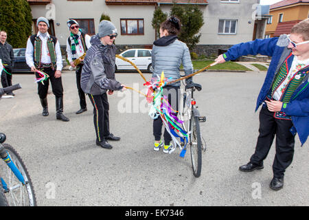Easter Monday - young boys passes through the village with a whip and whipping girls, Sakvice, Southern Moravia, - Stock Photo