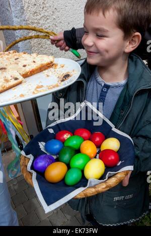 Easter Czech, Easter Monday, caroler - young boy with eggs, Sakvice, Moravia, Czech Republic - Stock Photo